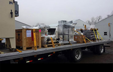 Image of ADICA truck hauling specialized freight.
